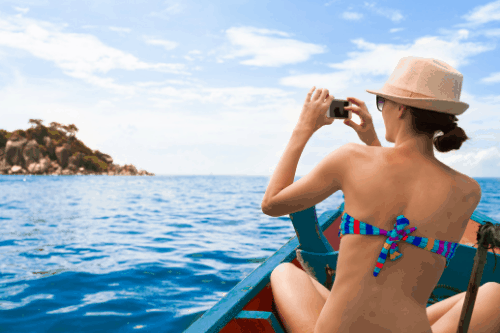 Video Footage of girl shooting video from a boat