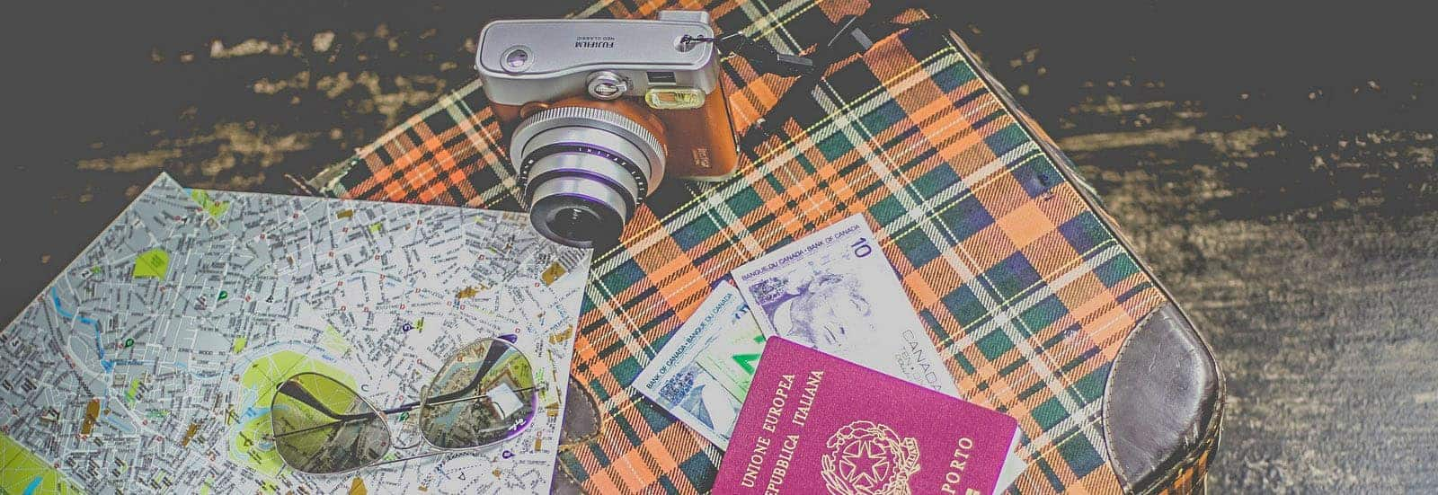 money to travel and travel gear on a table