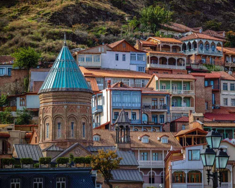 building and tower on the hill in tbilisi georgia