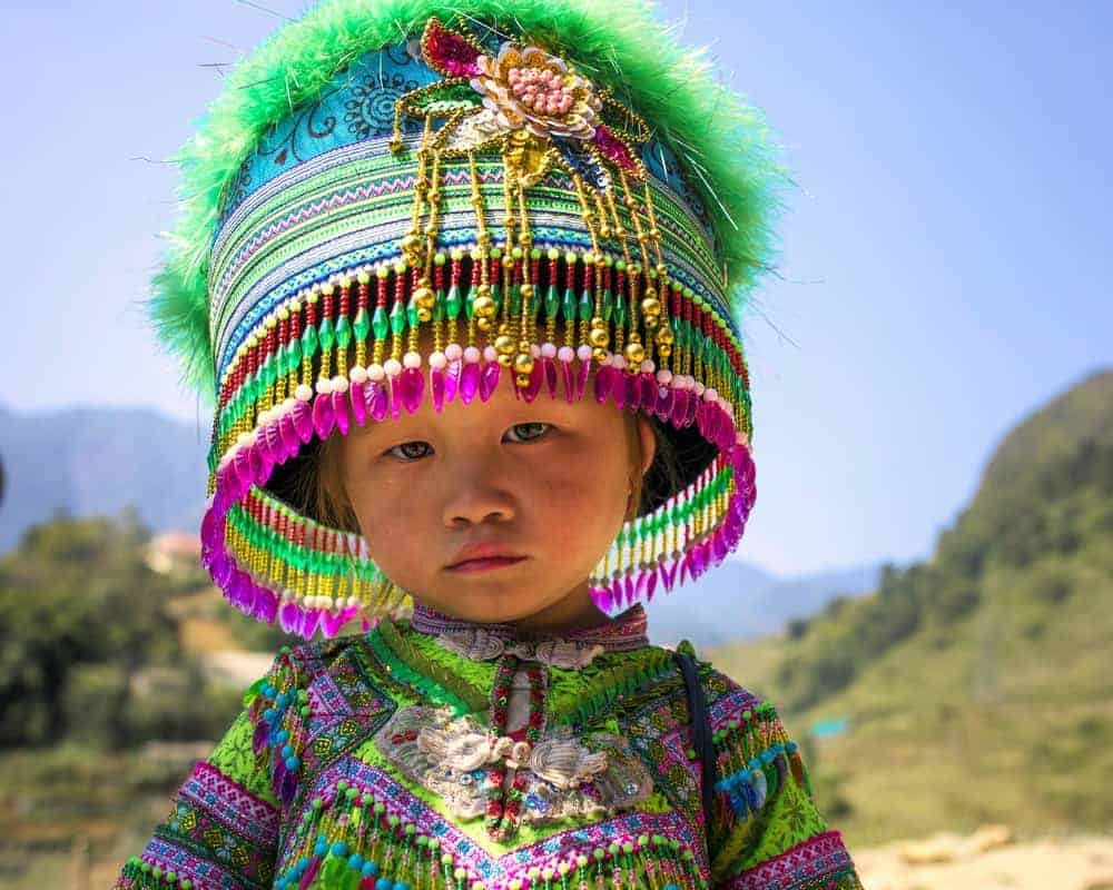 small child in traditional hmong dress
