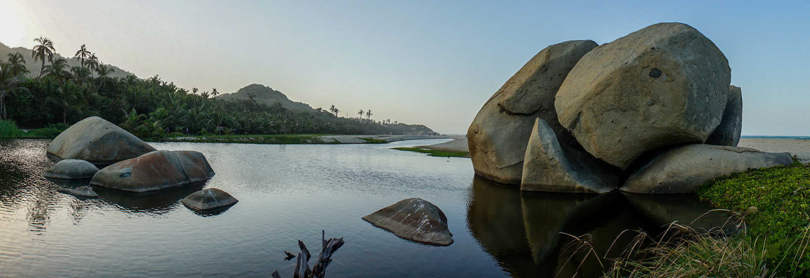 Feature Boulders on Tropical Beach in Tayrona National Park, Colombia.