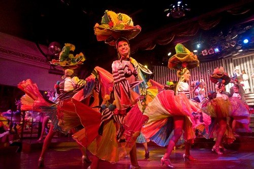 A team of graceful dancers dancing with joy in one of the performance in Parisien Cabaret, Havana, Cuba.