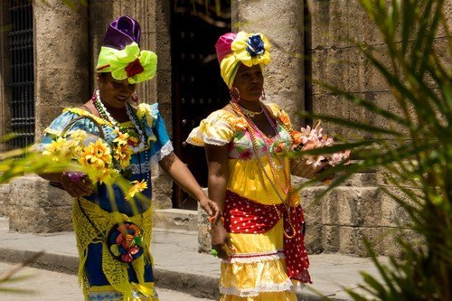 Cuban ladies dressed and going to a festival