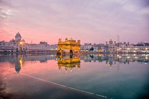 Golden Temple in Amritsar at sunset, Punjab, India. - Ultimate India Travel Guide