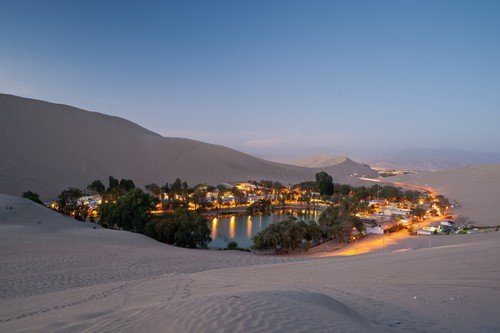 THis image shows the oasis town of Huacachina, Peru - ultimate peru travel guide