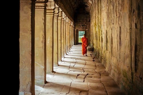 Monk in the hallway of the main Angkor Wat Temple