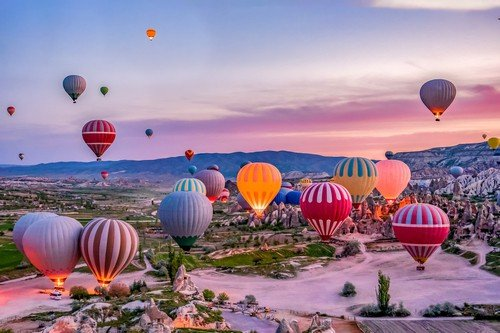 Colorful hot air balloons before launch in Goreme national park, Cappadocia, Turkey - Budget Turkey Travel Guide