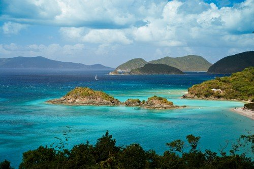 Sailboats and mountains on the horizon at the famous Trunk Bay St. John US Virgin Islands