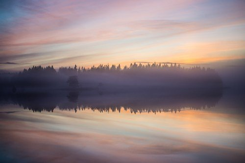 Sunrise mists over an inland sweedish lake - ultimate sweden travel guide