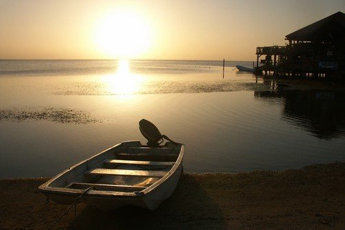 Boat on the shores of a Honduran inlet. - honduras travel guide