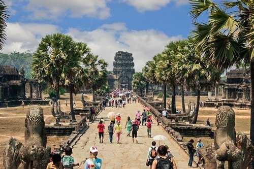 Tourists on the main road into Angkor Wat