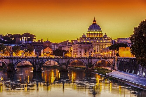 San Pietro Basilica and Ponte St Angelo at sunset. Rome, Italy