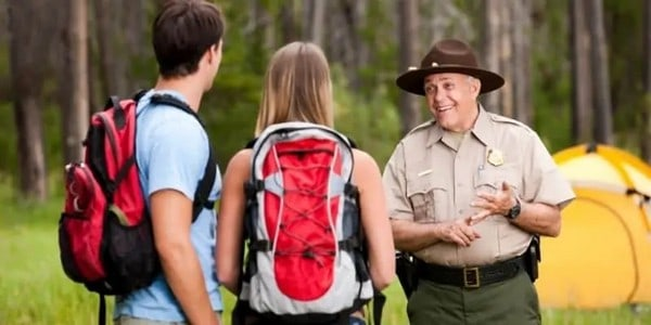 park-ranger-explaining-rules-to-campers