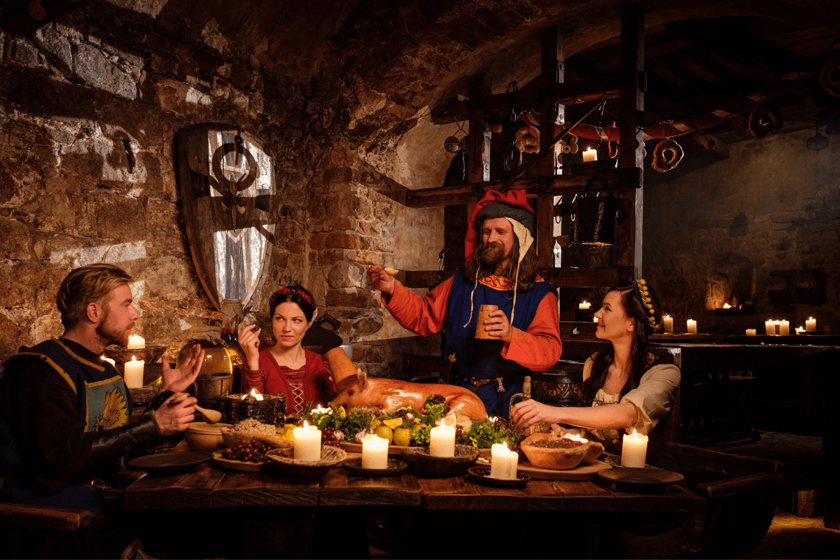 Italian people in traditional costume dining