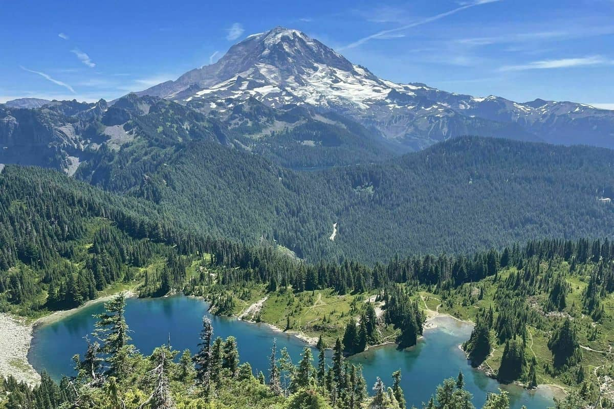 Aerial View of Mount Rainier with lake surrounded by trees in foreground - Boondockers Favorite Locations