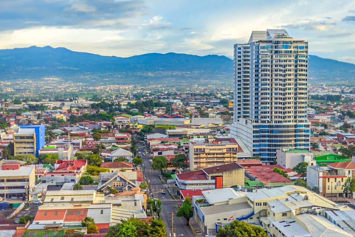 San Jose, Costa Rica capital city, street view with mountains in the background.